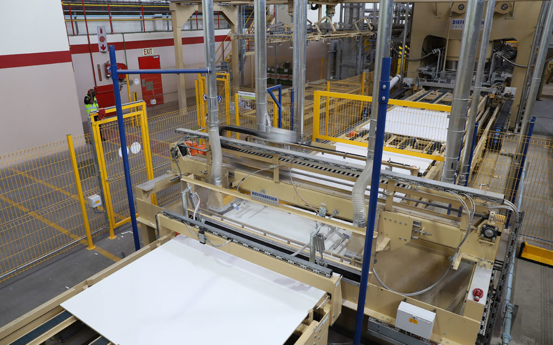 How melamine coated paper is laminated onto boards
